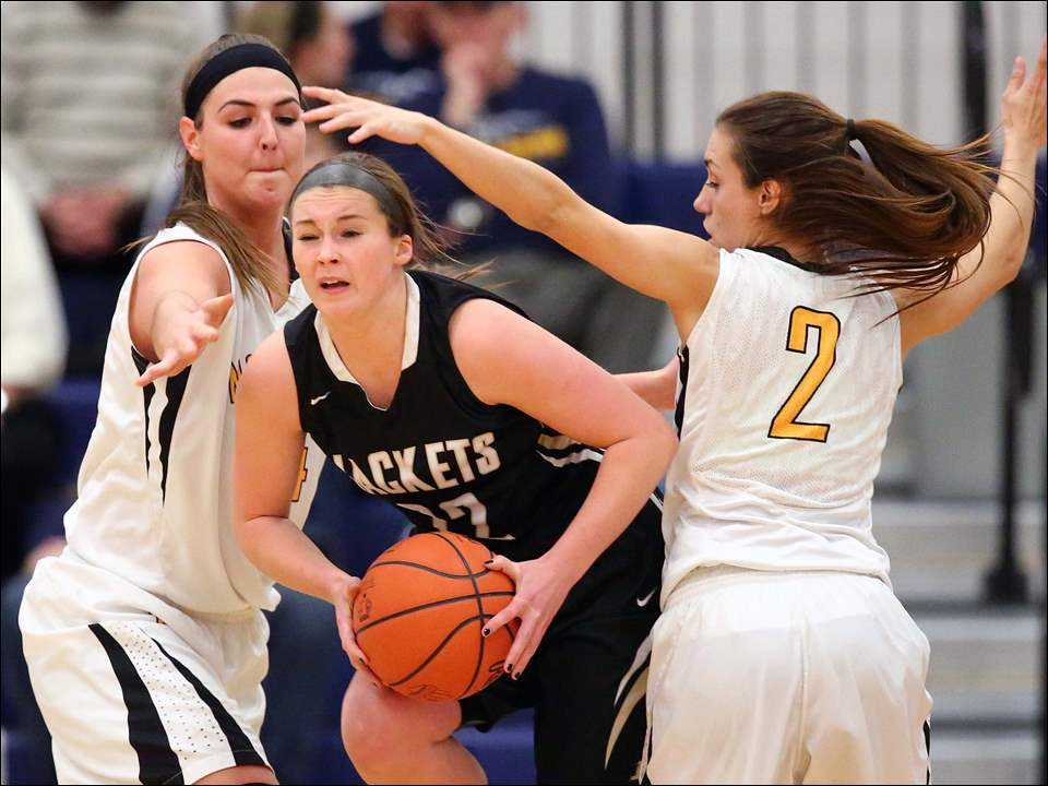 Sylvania Northview's Kendall Jessing (54) and Haley Archibeque (2) defend against Perrysburg's Lindy DeLong (22).