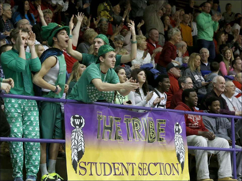 Central Catholic fans react to a 3-pointer.