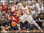 Wisconsin's Frank Kaminsky, left, posts up against Ohio State's Trey McDonald during the second half at the Schottenstein Center in Columbus. Kaminsky led the No. 6-ranked Badgers with 20 points.