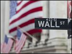FILE - In this Aug. 8. 2011 file photo, a Wall Street sign hangs near the New York Stock Exchange, in New York. The U.S. stock market is opening modestly higher Monday, March 9, 2015, following a sell-off Friday. (AP Photo/Jin Lee, File)