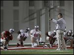 Ohio State head coach Urban Meyer directs is players during the team's first  NCAA college football practice of the spring at the Woody Hayes Athletic Center, Tuesday, March 10, 2015, in Columbus, Ohio.