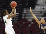 Eastern Michigan 5-foot-2 guard Cha Sweeney, a Rogers graduate who has 29 points, shoots against UT's Brenae Harris.