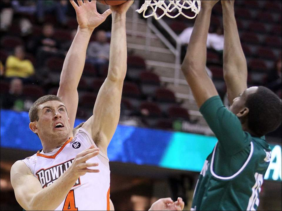 Bowling Green State University guard Zack Denny (4) shoots against Eastern Michigan.