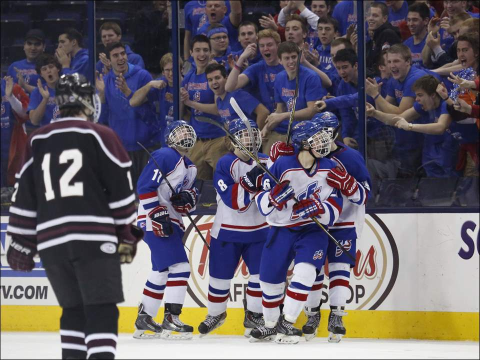 St. Francis de Sales players celebrate a goal in front of their fans.