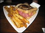 Reuben sandwich with homemade french fries from Martini & Nuzzi's.