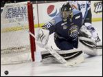 Walleye goaltender Neil Conway stops a shot in the second period against Orlando. He made 34 saves.