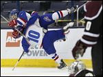St. Francis' Mike White, top, leaps on teammate Kyle Bloom after scoring a goal against University School during the first period of the Knights' victory in a Division I hockey semifinal in Columbus on Thursday. St. Francis advances to play Lakewood St. Edward for the championship on Saturday.