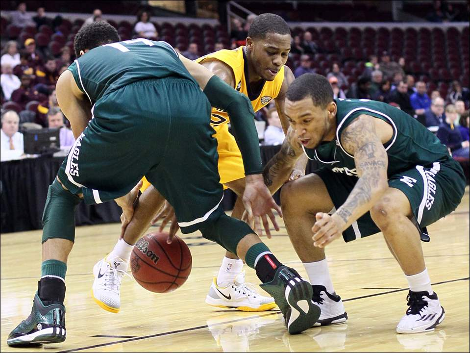 University of Toledo guard Julius Brown (20) battles Eastern Michigan forward Karrington Ward (14) and forward Anali Okoloji (3).