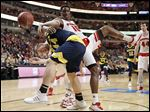 Michigan's Max Bielfeldt, left, and Wisconsin's Nigel Hayes tangle as they battle for a rebound in the first half. Hayes, a Whitmer graduate, had 11 points and nine rebounds.