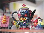 A variety of teapots and their accessories, including pieces by Romero Britto, are featured at Clara J's Tea Room in Maumee.