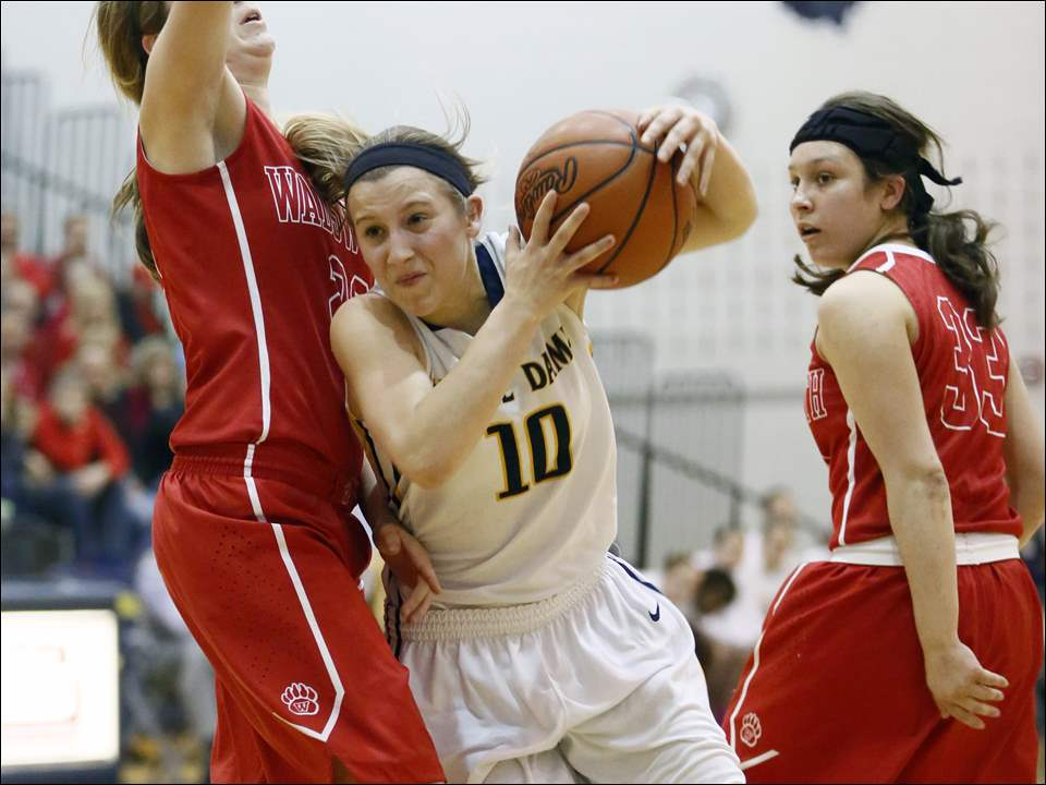 Notre Dame's Jami Huth (10) drives past Wadsworth's Laurel Palitto (22).