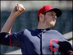 Cleveland Indians' Trevor Bauer throws a pitch against the San Diego Padres during the first inning of a spring training baseball game Sunday, March 15, 2015, in Goodyear, Ariz. (AP Photo/Ross D. Franklin)