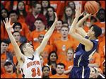 Myles Copeland, who had 15 points, shoots against Southview's Ben Casanova in a Division I district final.