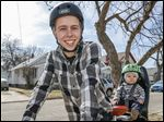 Jordan Justice, with his son Cohen, 8 months,  is Toledo's 30 Days of Biking captain. An avid cyclist anyway, Mr. Justice plans to bike his 12-mile commute to work when he can. As well as helping children, riding encourages healthy goals.