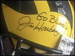 ‎Michigan coach Jim Harbaugh autographed a helmet for MAGnificent Memories, a dinner and silent auction to raise awareness of suicide prevention.