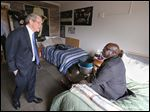 Ohio Attorney General Mike DeWine, left, visits with recovering heroin addict Tachumbi Williams in his room at a Zepf Center facility on Collingwood Boulevard.