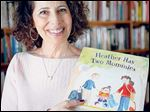 Author Leslea Newman displays a copy of her seminal book, 'Heather Has Two Mommies.'