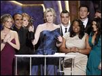 'Glee' cast members, from left, Jessalyn Gilsig, Iqbal Theba, Jayma Mays, Jane Lynch, Mark Salling, Amber Riley, Cory Monteith, and Lea Michele accept the award for best ensemble in a comedy series at the 2010 Screen Actors Guild Awards.