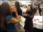 Student Jessica Chang, left, is congratulated and photographed by her sister, Cheryl Chang, after learning Friday of her placement into the UCLA Medical Center during Match Day at the Stranahan Theater's Great Hall.