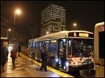 Passengers board a TARTA bus in downtown Toledo.