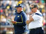 Greg Mattison, left, is the only holdover from the staff of Brady Hoke, who was replaced by Jim Harbaugh after last season.