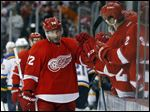 Detroit Red Wings right wing Erik Cole, left, celebrates his goal against the St. Louis Blues in the third period of an NHL hockey game in Detroit, Sunday, March 22, 2015. (AP Photo/Paul Sancya)