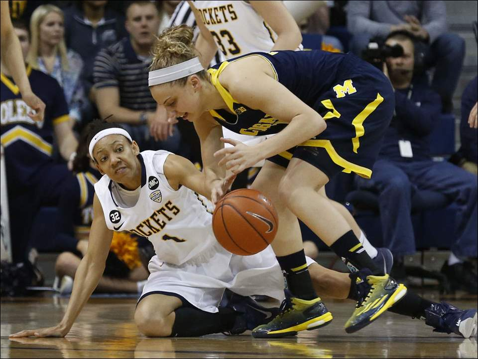 Toledo's Brenae Harris and Michigan's Katelynn Flaherty battle for the ball.