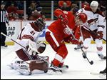 Arizona Coyotes goalie Mike Smith (41) stops a shot redirected by Detroit Red Wings left wing Justin Abdelkader (8) during the second period in Detroit Tuesday.
