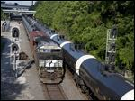 Empty and loaded oil trains pass each other just west of I-75 near downtown Toledo.