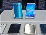 Two new Samsung phones, Galaxy S6, top left, and Galaxy S6 Edge, to right, are on display with choice of color selections at a special media preview in New York.