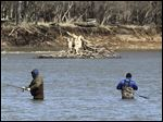 Fishermen try their luck while hoping to catch a walleye on the Maumee River in Maumee. Anglers from across the Midwest come for the walleye run.