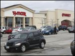 The parent companies of TJ Maxx and Target, here on U.S. 20 in Rossford, will raise starting wages to $9 an hour.
