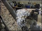 Paper coming out of the shredder at Allshred Services in Maumee, Ohio
