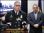 Toledo police Chief George Kral, with Lt. Dan Gerken, right, speaks during a news conference at Government Center in Toledo about the death of Aaron Pope.