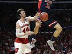 Arizona center Kaleb Tarczewski (35) dunks over Wisconsin forward Frank Kaminsky (44) during the first half of a college basketball regional final in the NCAA Tournament, Saturday, March 28, 2015, in Los Angeles. (AP Photo/Jae C. Hong)
