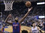 Detroit Pistons' Andre Drummond (0) grabs a rebound in front of Orlando Magic's Nikola Vucevic (9).