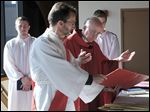 The Rev. Charles Ritter blesses the palms during a service at St. Patrick of Heatherdowns on Saturday.