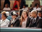 Cynthia Ford, center left, wife of Jack Ford, and Mr. Ford's daughter, Jacqueline Ford, sit with other family members as the public paid their respects to the late Mr. Ford during an afternoon visitation Sunday at Warren AME Church.