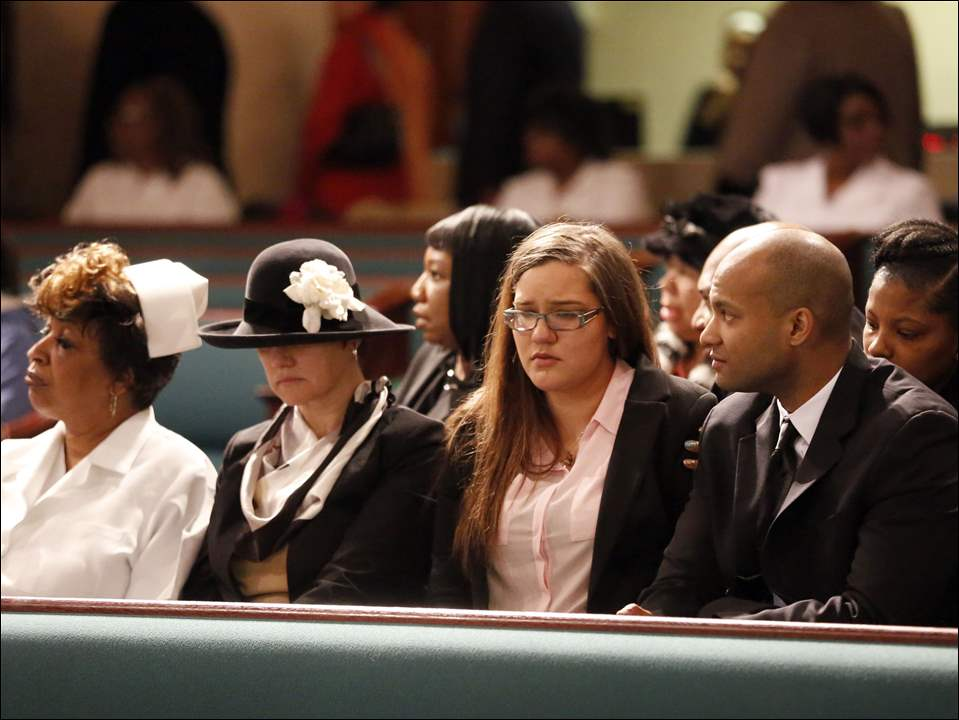 From left, mourner Janice Fryar, Cynthia Ford, wife of Jack Ford, daughter Jackie Ford, and, son Ryan at Jack Ford's public viewing at Warren AME Church Sunday.