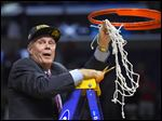 Wisconsin head coach Bo Ryan cuts down the net after Wisconsin beat Arizona 85-78 in a college basketball regional final in the NCAA Tournament to advance to the Final Four.