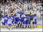 The St. Francis de Sales hockey team celebrates after defeating Lakewood St. Edward 3-1 in the state final at Nationwide Arena in Columbus. The Knights also won the title in 2011.