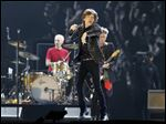 Mick Jagger and the Rolling Stones perform during their concert at Tokyo Dome in Tokyo in February, 2014.