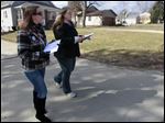 Rossford teachers Erika Schadlet, left, and Kirsten Johnson go door-to-door to conjure up levy support.