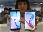The Galaxy S6, right, and S6 Edge are the latest offerings by Samsung.  The South Korean-based company is hoping that the new models will return Samsung to relevance.