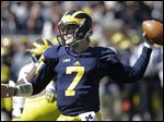 Blue team quarterback Shane Morris looks to move the ball downfield during the University of Michigan spring game. Morris threw for 135 yards on Saturday including a 14-yard touchdown pass to receiver Jaron Dukes.