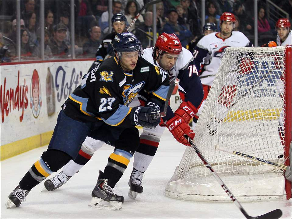 Walleye forward Alden Hirschfeld (23) moves the puck against Elmira defender Nick Tuzzolino (74).