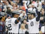The Tigers' Alex Avila, right, is congratulated by Yoenis Cespedes after Avila's two-run home run during the second inning Monday in Detroit.