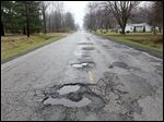 Temperance Road is lined with potholes from Secor Road to Summerfield Road in Bedford Township.