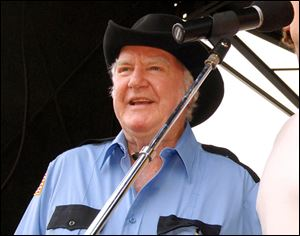 'Dukes of Hazzard' cast member James Best sings during the DukesFest 2005 at the Bristol Motor Speedway in Bristol, Tenn.