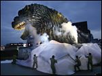 Godzilla's head is unveiled as the irradiated monster was appointed special resident and tourism ambassador for Tokyo's Shinjuku ward during its awards ceremony in Tokyo Thursday.